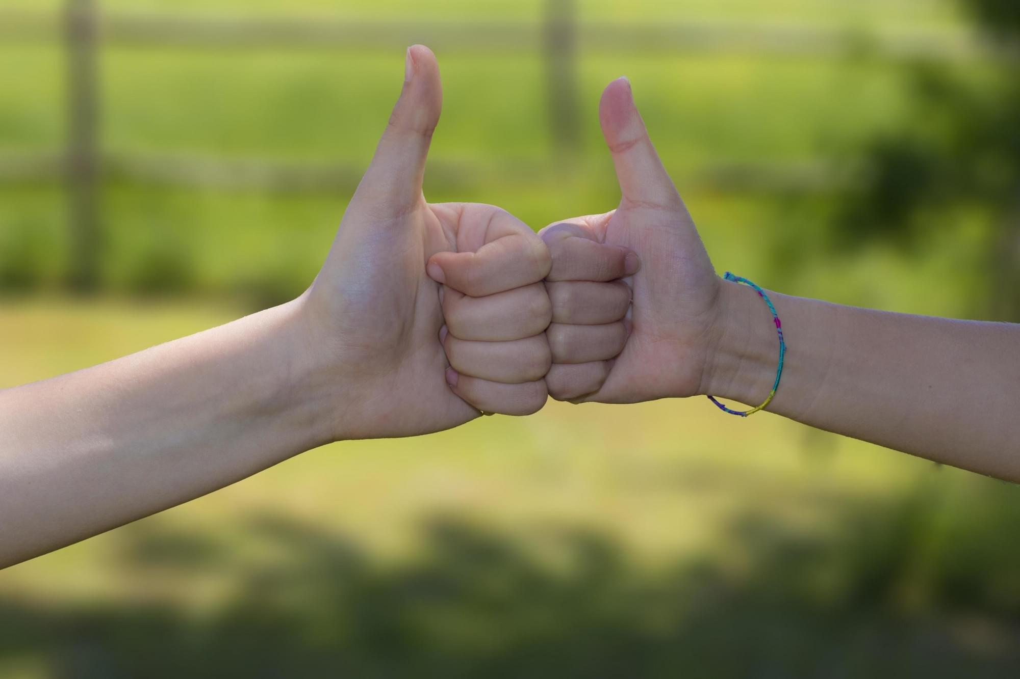 two-hands-give-a-thumb-s-up-free-photo